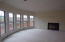 Family room, beautiful windows and fireplace