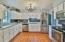 White cabinets with ss appliances