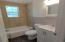 Hall bath with new fixtures, floors and paint.