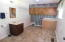 Large laundry area & half bath, great potential to create more organization