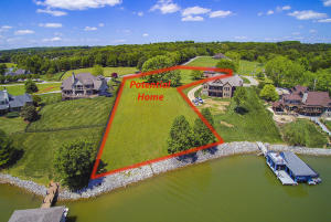Over 3 Acres with 150 ft lakefrontage