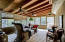 Porch Features Wood Beams, Ceiling Fans and Incredible View