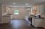Recessed lighting and easy care flooring. Kitchen is light and bright.
