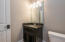 Powder Room with custom cabinetry & ceramic tile floors