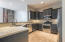 Large Kitchen with custom painted cabinetry & granite countertops