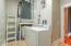 Full-size Utility Room offering ceramic tile floors & extra storage