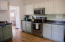 Large kitchen w/painted cabinets & newer appliances