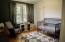 Large bedroom w/shiplap accent wall, hardwood floors
