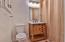 Master bath with sky light tube for natural lighting.