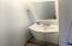 Powder room on main level with tile
