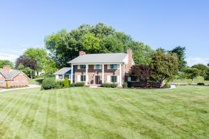 Updated 5,224 sq.ft. all Brick Custom built 5 Br 4.5 bth 2 sty finished basement home on .85 acre lot in the Suburban Hills! Solid Hwds on main, stairs & upstairs landing w/tile in all wet areas! 5 yr young Pella windows w/marble sills & mountain views! Roof 2012!