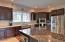 Gourmet Kitchen w/ double ovens & farmhouse sink