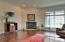 Great Room w/ fireplace and views of the lake