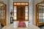 Custom made Mahogany front door w/ 13' entryway ceilings