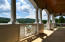 Luxurious front porch w/ lake views and wood plank ceiling