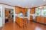 Custom Cherry Cabinets & Tile Floors