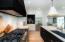 Coffee Bar emerges from the custom built-in cabinetry with solid walnut interior, microwave and storage