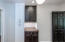 Butler's Pantry with black and white cabinetry and solid wood countertops