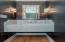 Floating Carrera Marble Vanity, Brass Faucet, Visual Comfort Lighting