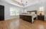 Master suite features trey ceiling, 4 windows & designer lighting