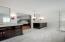 Carrera marble floor, Designer Lighting, Carrera marble tops sits on the black vanities