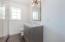 Bedroom 2's en suite features a black limestone herringbone floor and beautiful vanity with marble top