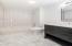 Bedroom 4's en suite features carrera marble hex tile floor, carrera marble topped deep gray vanity and subway tile tub/shower