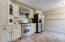 Kitchen with Neutral Cabinets and Updated Stainless Steel Appliances