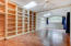 Large, Bright, Master Bedroom with Loads of Shelving