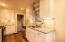 Galley Kitchen with granite countertops and stainless appliances