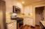 Kitchen with travertine backsplash