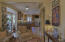 French doors open to spacious screened porch to enjoy 9 months of the year. Wooded and private setting