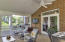 Fabulous screened porch with vaulted ceiling just off kitchen/gathering room.