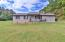 All brick ranch with rocking chair front porch.