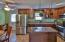 Remodeled kitchen with updated cabinets, newer appliances and countertops.
