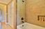 Hall bath, gorgerous tiled surround.