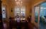 Dining room features arched doorway & French doors