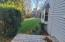 Small deck off sunroom overlooks level yard