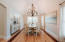 Vaulted ceiling with custom lighting and natural light galore!