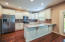 Stainless appliances. Granite countertops. Tile backsplash.