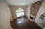 Vaulted Ceiling. Large windows overlooking back yard.