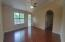 Open living area with cathedral ceilings