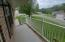 Covered front porch overlooking corner lot