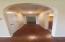 Arched doorways, wood floors