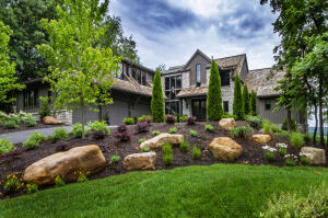 Crafted of stone & wood siding