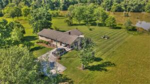 Nice setting with large lake front backyard. Convenient location along Louisville Rd near Topside Rd and access to I-140.