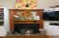 Wood Burning Fireplace with Custom Built Ins