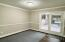 Newer upgrades include laminate flooring, crown molding and chair rail