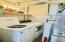 Utility room off kitchen, newer commercial washer and dryer stay