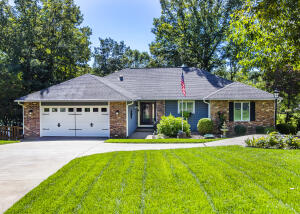 Great curb appeal with a stained circular driveway!